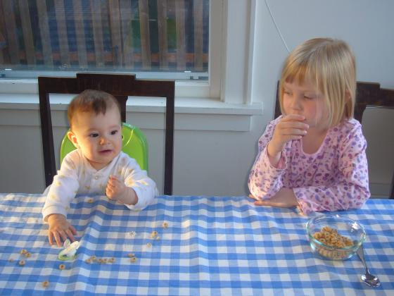 Sharing their cheerios at breakfast
