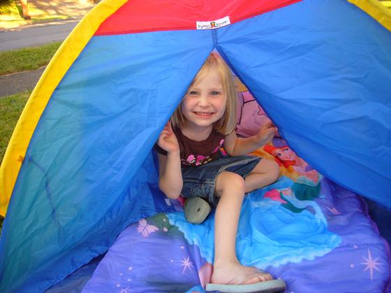 Sophie playing in her tent