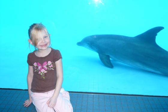 Sophie with a dolphin