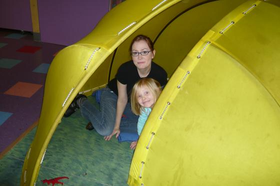 Becky and Sophie playing in a tent