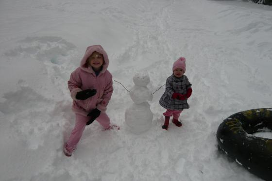 Sophie and Lillie with their snowman