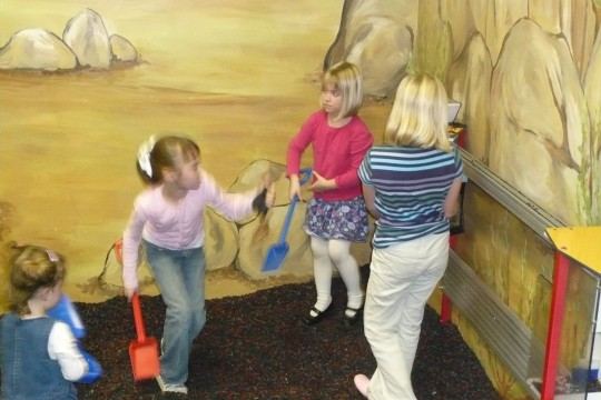 Lillie, Haleigh, Emma and Sydney playing in the construction area.