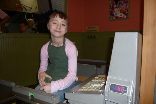 Haleigh working the cash register