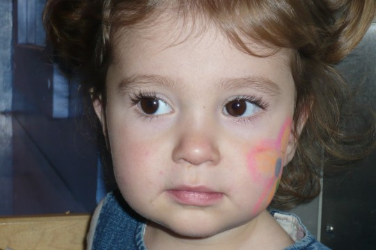 Lillie got a flower painted on her face by Allison, Haleigh's mom, but she didn't understand that she needed to turn her head in order to show it off.