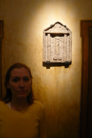 "Becky with some art from the ""secret room"" in the museum"