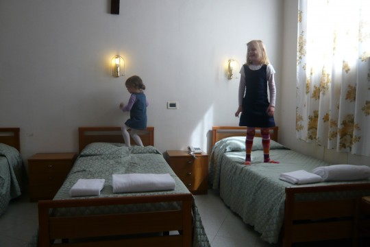 The girls enjoying the beds in the convent we stayed in