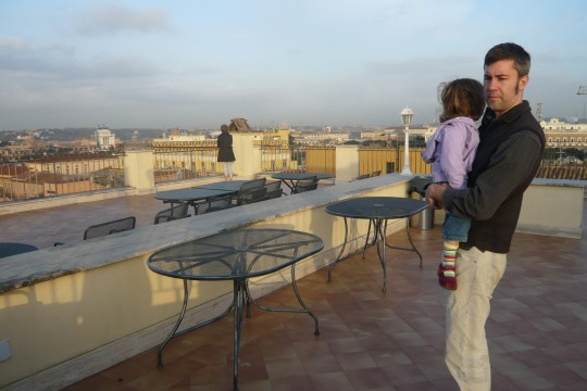 Enjoying the sunrise and our last view of Rome from our hotel roof before heading home